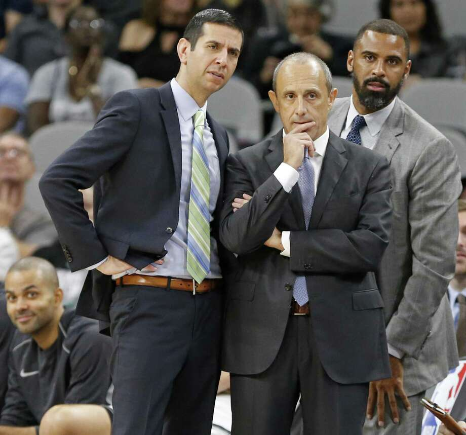 San Antonio Spurs assistant coaches James Borrego (from left), Ettore Messina, and Ime Udoka huddle during a second half timeout against the Dallas Mavericks Monday Nov. 27, 2017 at the AT&T Center. The Spurs won 115-108. Photo: Edward A. Ornelas,  Staff / San Antonio Express-News / © 2017 San Antonio Express-News