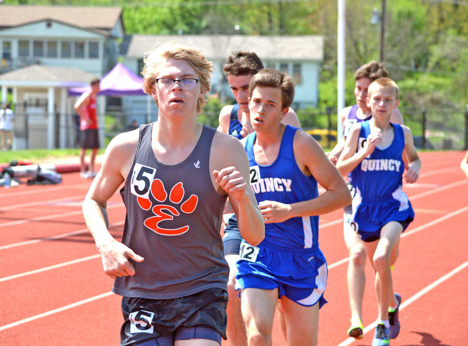 Edwardsville sophomore Henry Gruben, left, competes in the 3,200-meter run on Saturday at the Collinsville Invitational.