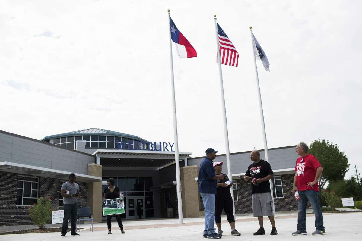 Candidate supporters stand on front of Westbury High School on the day on which a special election for Houston?'s District K to replace the late Council Member Larry Green, Saturday, May 5, 2018, in Houston. Westbury High School is located at 11911 Chimney Rock Road. ( Marie D. De Jesus / Houston Chronicle )