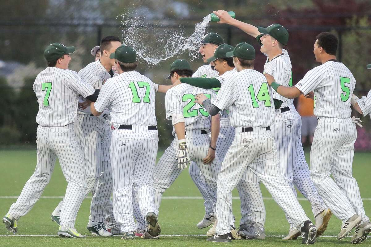 Norwalk celebrates after a walk-off line drive led the Bears to victory over McMahon on Saturday.