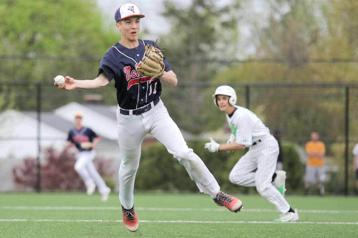 McMahon's Jack Fitzpatrick makes the throw to first base,