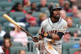 ATLANTA, GA - MAY 5: Alen Hanson #19 of the San Francisco Giants hits a fourth inning two-run home run against the Atlanta Braves at SunTrust Park on May 5, 2018 in Atlanta, Georgia. (Photo by Scott Cunningham/Getty Images)