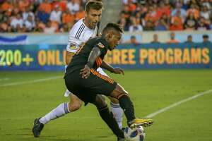 May 5, 2018:  Houston Dynamo forward Romell Quioto (31) keeps the ball away from Los Angeles Galaxy defender Dave Romney (4) during the MLS soccer match between the LA Galaxy and Houston Dynamo at BBVA Compass Stadium in Houston, Texas.  (Leslie Plaza Johnson/Freelance