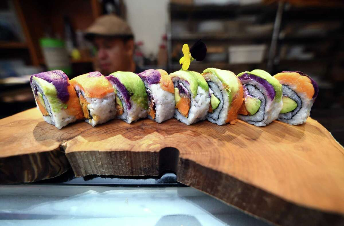 A Sweet Goatato roll incorporating sweet potato, avocado and goat cheese makes a colorful dish.