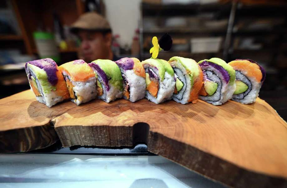 A Sweet Goatato roll incorporating sweet potato, avocado and goat cheese makes a colorful dish. Photo: Arnold Gold / Hearst Connecticut Media / New Haven Register