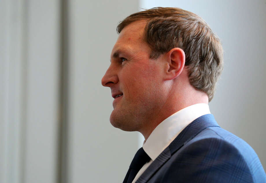 Dallas Cowboys tight end Jason Witten waits as a highlight video is played during a press conference at team's training facility and headquarters, Thursday, May 3, 2018, in Frisco, Texas, where he announced his retirement. (AP Photo/Richard Rodriguez)