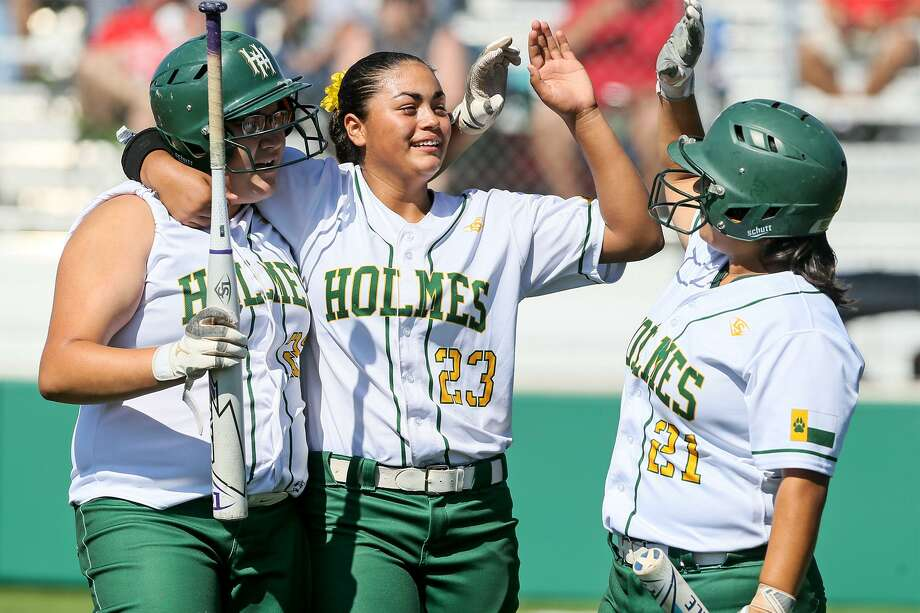 Holmes' Alissa Martinez (from left) celebrates with teammates Ariana Martinez and Reina Herrera after hitting a second inning home run during their Class 6A second-round playoff series with Cedar Park Vista Ridge at the Marion High School softball field on Saturday, May 5, 2018.  Holmes won the game 5-4, sweeping the series in two games.  MARVIN PFEIFFER/mpfeiffer@express-news.net Photo: Marvin Pfeiffer, Staff / San Antonio Express-News / Express-News 2018