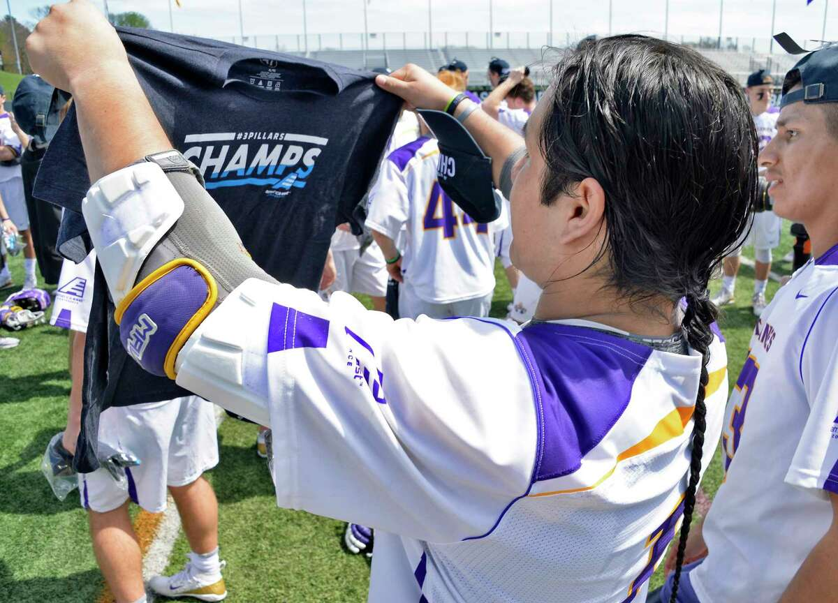 UAlbany's Tehoka Nanticoke checks out an America East lacrosse championship T-shirt after their win over Vermont Saturday May 5, 2018 in Albany, NY. (John Carl D'Annibale/Times Union)