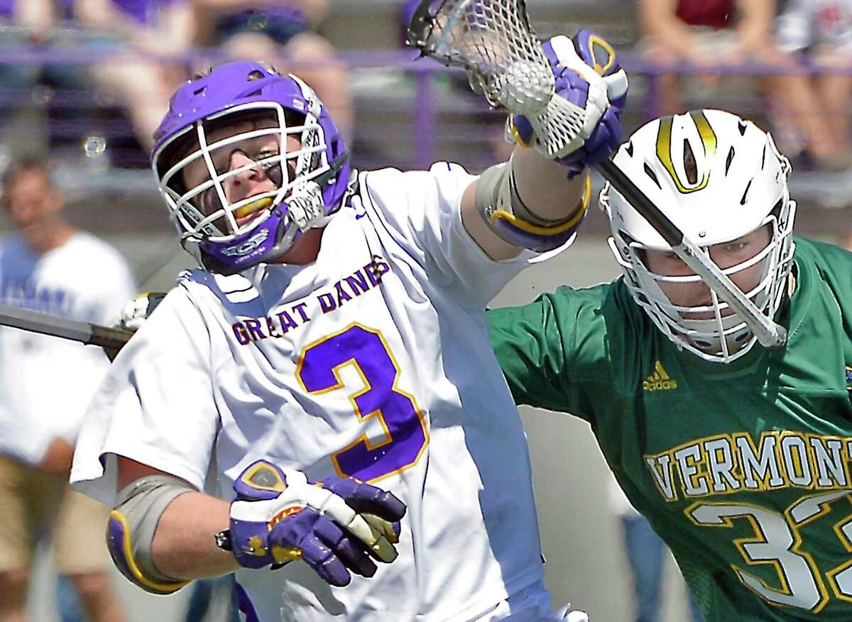 UAlbany's #3 TD Ierlan, left, breaks away from Vermont's #33 Charlie Erdmann during their America East championship game Saturday May 5, 2018 in Albany, NY. (John Carl D'Annibale/Times Union)
