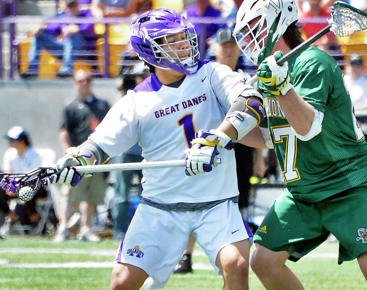 UAlbany's #1 Tehoka Nanticoke, left, battles Vermont's #27 Warren Jeffrey during their America East championship game Saturday May 5, 2018 in Albany, NY. (John Carl D'Annibale/Times Union)