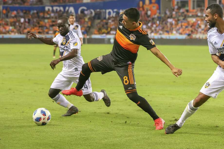 May 5, 2018:  Houston Dynamo midfielder Memo Rodriguez (8) reaches to keep the ball away from Los Angeles Galaxy midfielder Ema Boateng (24) during the MLS soccer match between the LA Galaxy and Houston Dynamo at BBVA Compass Stadium in Houston, Texas.  (Leslie Plaza Johnson/Freelance Photo: Leslie Plaza Johnson, For The Chronicle / Freelance