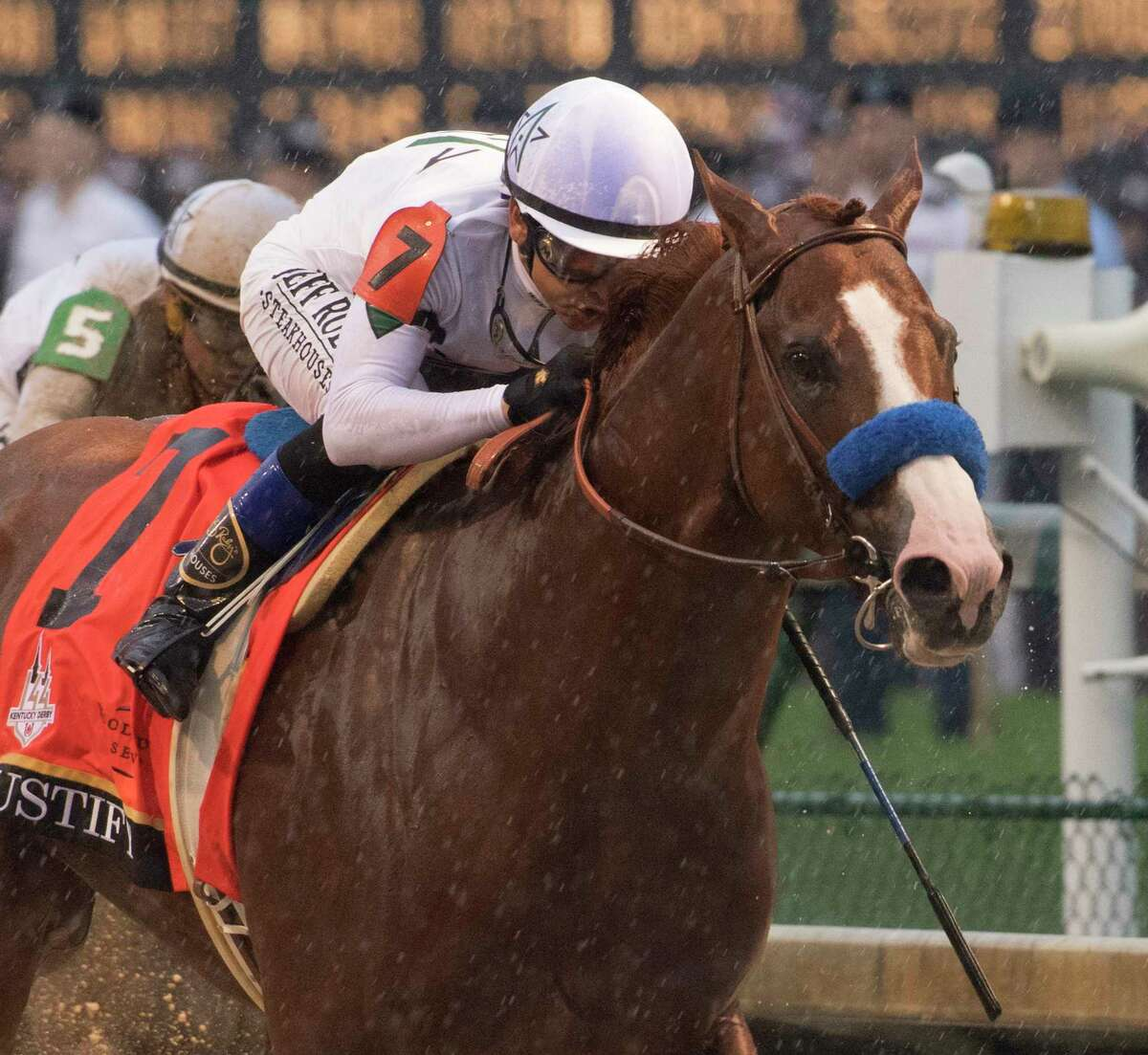 Justify with jockey Mike Smith goes to the lead from the to win the 144th running of the Kentucky Derby at Churchill Downs Saturday May 5, 2018 in Louisville, Kentucky (Skip Dickstein/Times Union)