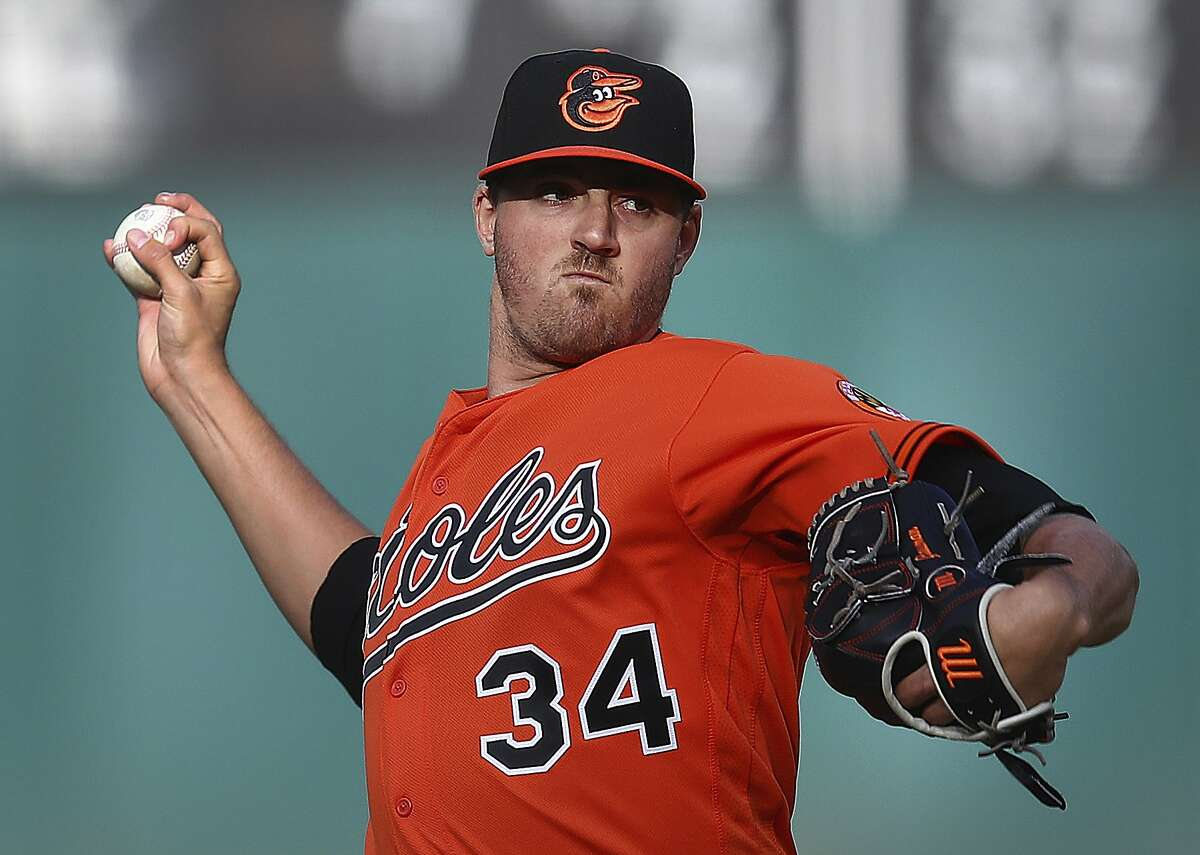 Baltimore Orioles pitcher Kevin Gausman works against the Oakland Athletics during the first inning of a baseball game Saturday, May 5, 2018, in Oakland, Calif. (AP Photo/Ben Margot)
