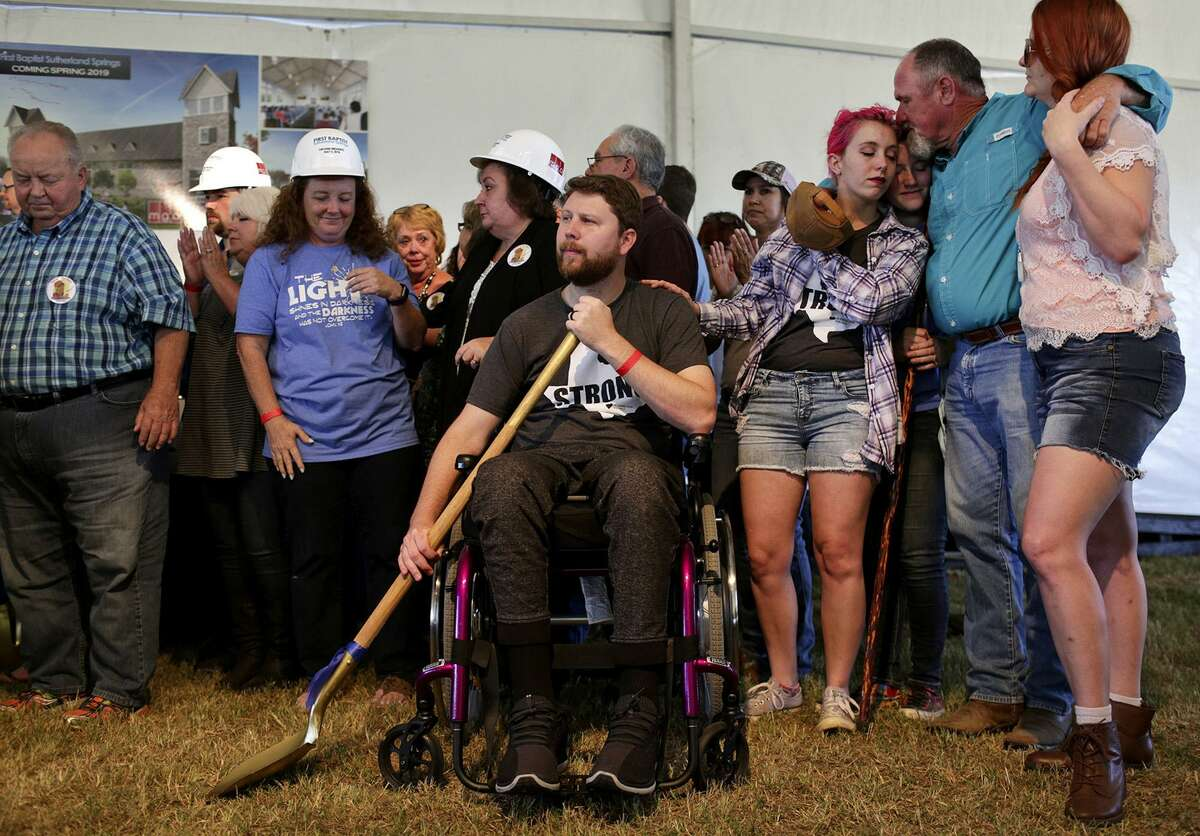 Kris Workman, center, who was shot and paralyzed, joins survivors of the mass shooting at First Baptist Church of Sutherland Springs for the survivors' groundbreaking during the Groundbreaking Celebration for the church on May 5, 2018, the six-month anniversary of the shooting. At right is Kris' wife, Colbey Workman, from left, her sister, Morgan Workman (who is married to Kris' brother), their father, Darrell Harris, and their sister, Chelsi Pomeroy.