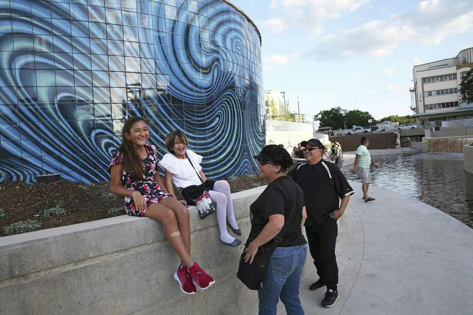 Families enjoy the new park at San Pedro Creek Culture Park on May 5, 2018. A reader asks the city to keep up the parks that already exist before building more. Photo: Tom Reel /San Antonio Express-News / 2017 SAN ANTONIO EXPRESS-NEWS
