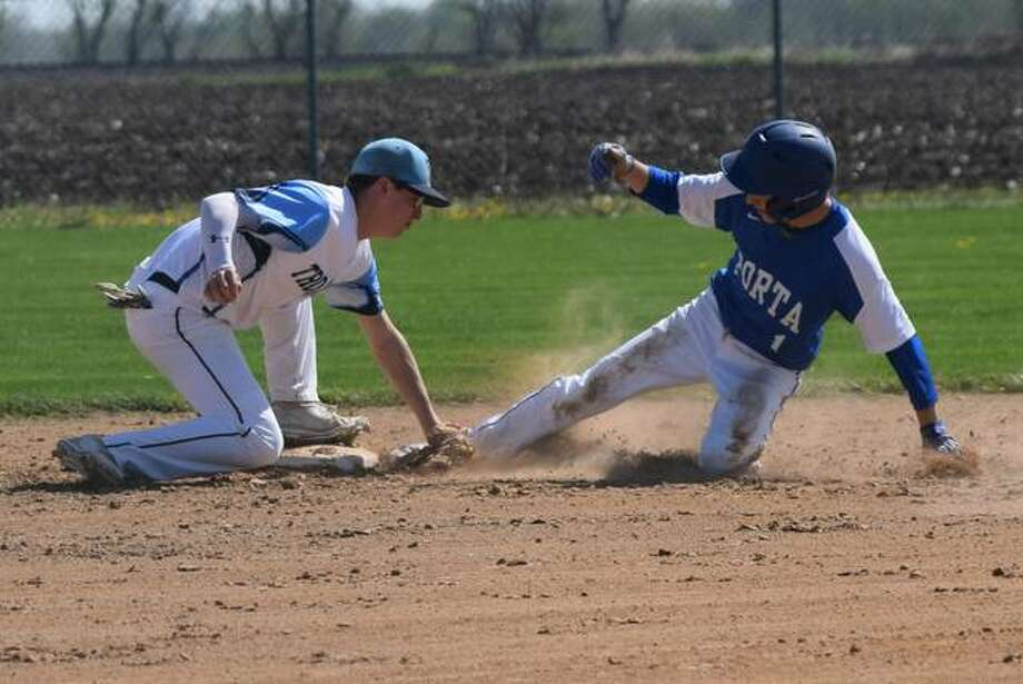 Triopia's Broc Moore tries to tag out PORTA/A-C Central's Blake Marr at second base Saturday at Concord. Marr was called safe.
