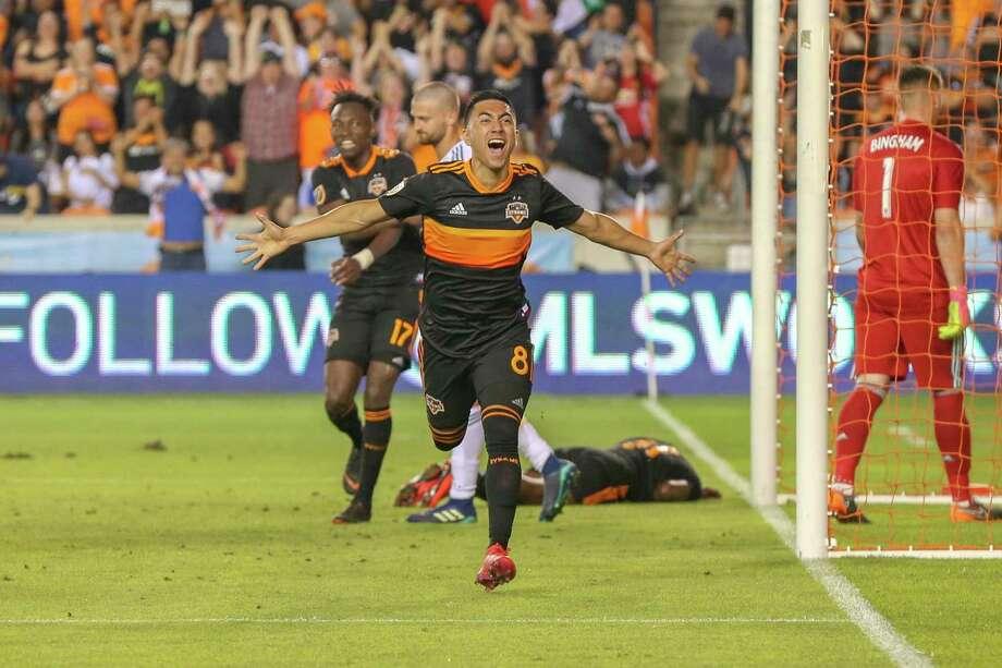 Dynamo midfielder Memo Rodriguez celebrates his game-winning goal against the Galaxy and goalkeeper David Bingham, right. Photo: Leslie Plaza Johnson, Freelancer / For The Chronicle / Freelance