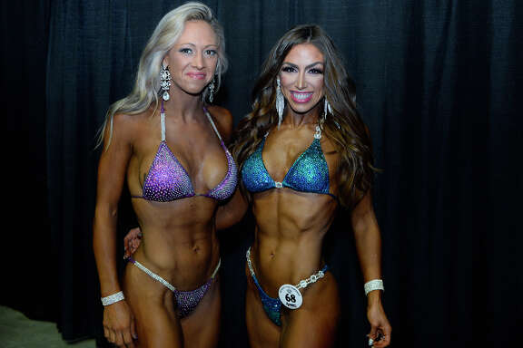 Catherine Habaugh and Vivian Rodick during the Southeast Texas Championship bodybuilding and physique competition at the Beaumont Civic Center.  Photo taken Saturday 5/5/18 Ryan Pelham/The Enterprise