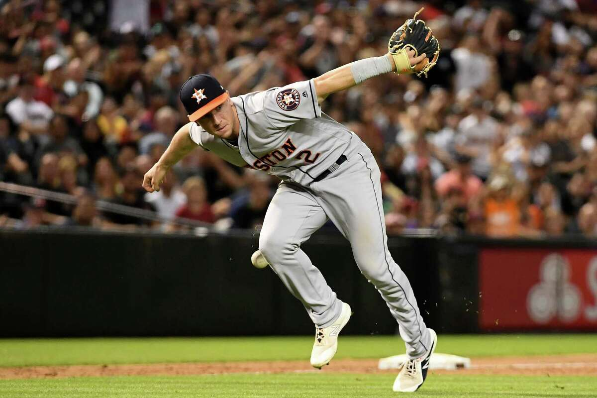 PHOENIX, AZ - MAY 05: Alex Bregman #2 of the Houston Astros drops the ball while attempting to field the ground ball ninth inning of the MLB game against the Arizona Diamondbacks at Chase Field on May 5, 2018 in Phoenix, Arizona.