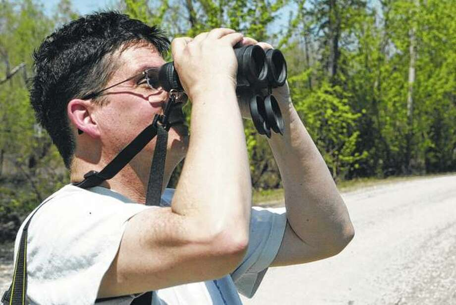 Veteran bird-watcher Allen Yow of Jacksonville looks for birds Saturday north of Meredosia during the annual spring bird count in Morgan County, which was part of a two-day statewide effort to record bird populations. Photo:       Greg Olson | Journal-Courier