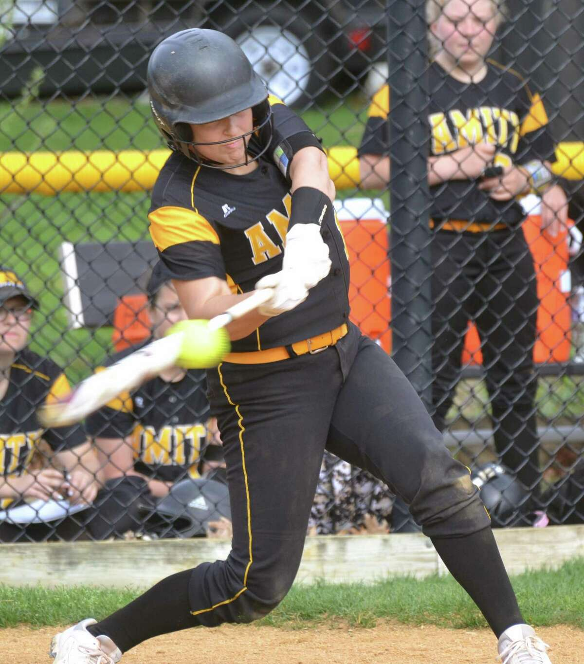 Amity's Brooke Malyasovsky makes contact against Hand on Saturday.