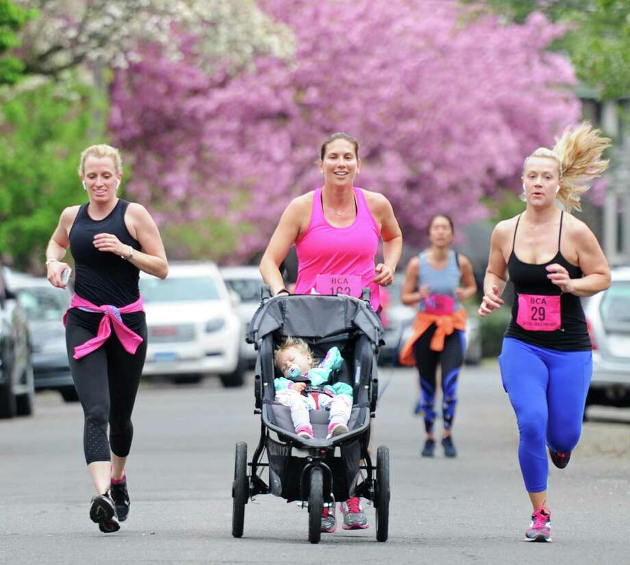 Greenwich's Sarah Sippel pushes her sleepy child, Remy Sippel, 1, in a stroller beside fellow Greenwich residents Chalon Lefebvre, left, and Elizabeth Coehlo at the Breast Cancer Alliance 5K Run/Walk for Hope at Richards in Greenwich, Conn. Sunday, May 6, 2018. Hundreds of partcipants ran and walked through the streets of Greenwich, looping from Richards in central Greenwich out to Bruce Park and back. Funds raised by the event went to the Breast Cancer Alliance, a nonprofit that invests in cancer research, breast surgery fellowships, regional education, dignified support, and screening for the underserved. Photo: Tyler Sizemore / Hearst Connecticut Media / Greenwich Time