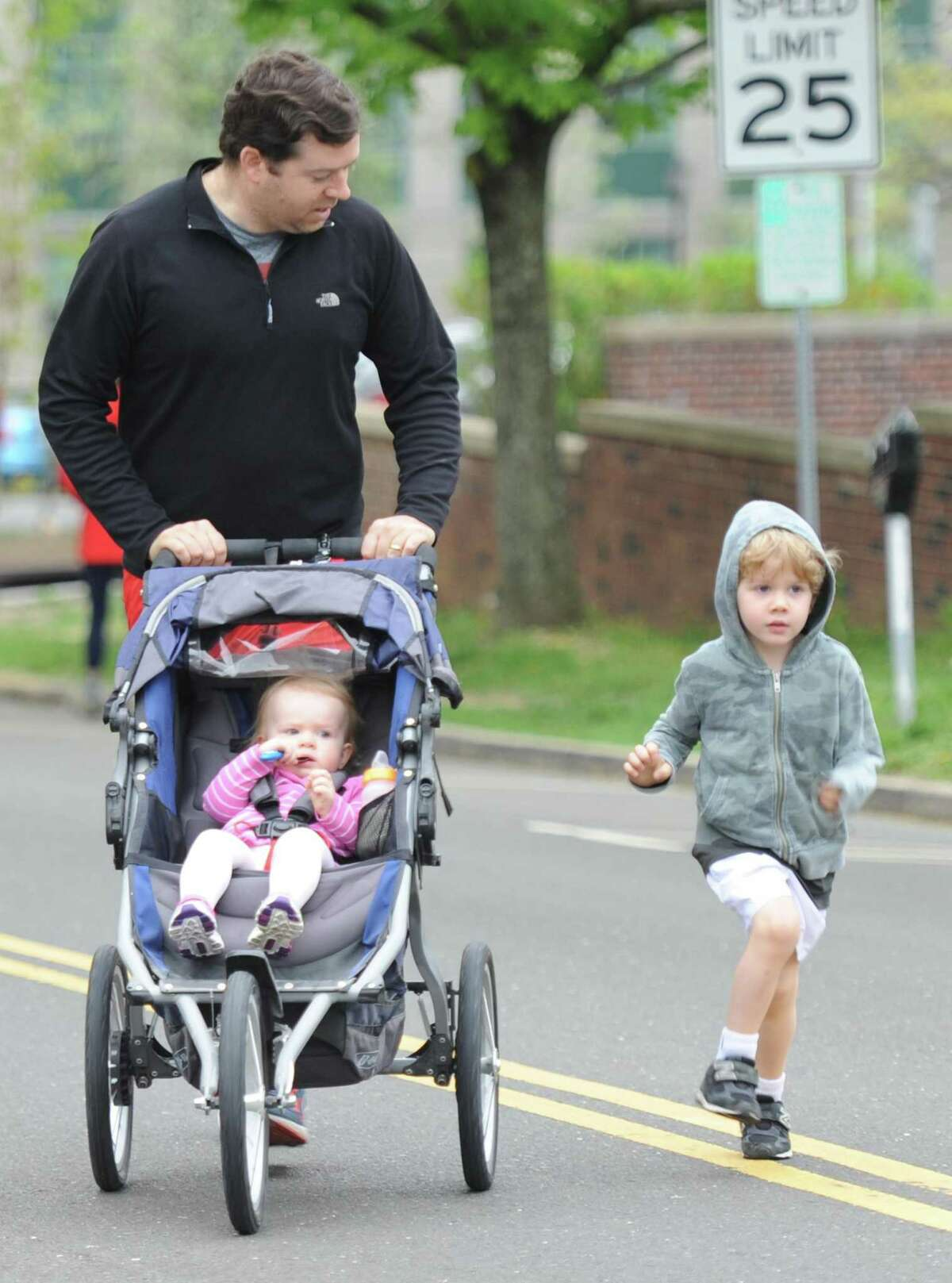 Photos from the Breast Cancer Alliance 5K Run/Walk for Hope at Richards in Greenwich, Conn. Sunday, May 6, 2018. Hundreds of partcipants ran and walked through the streets of Greenwich, looping from Richards in central Greenwich out to Bruce Park and back. Funds raised by the event went to the Breast Cancer Alliance, a nonprofit that invests in cancer research, breast surgery fellowships, regional education, dignified support, and screening for the underserved.