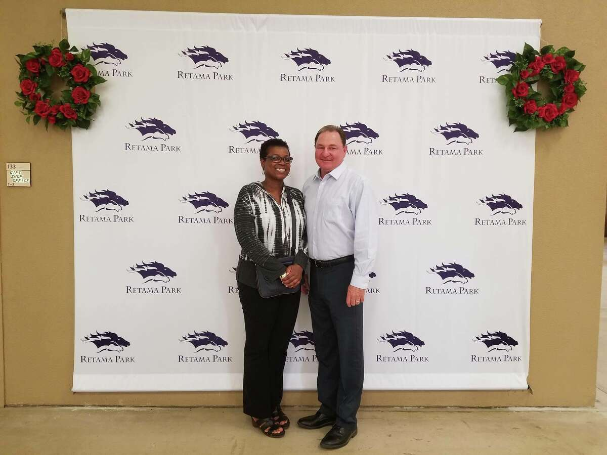 Margaret Reid of Austin, who won $1.2 million on an $18 bet made at Retama Park in Selma on May 5, 2018, poses for a photo with Retama Park vice president and general manager Bill Belcher.