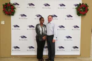 The woman who won $1.2 million on an $18 bet made at Retama Park in Selma on May 5, 2018, poses for a photo with Retama Park vice president and general manager Bill Belcher. The woman, who requested to not be identified, picked the top five horses in the order they finished in the Kentucky Derby.