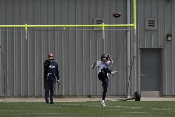 Seattle Seahawks punter Michael Dickson kicks Friday, May 4, 2018, during NFL football rookie camp in Renton, Wash. (AP Photo/Ted S. Warren)