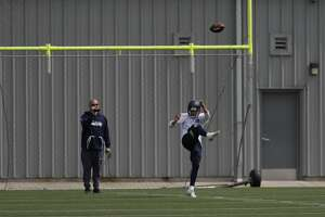 Seattle Seahawks punter Michael Dickson kicks Friday, May 4, 2018, during NFL football rookie camp in Renton, Wash. (AP Photo/Ted S. Warren)