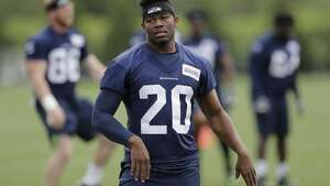 Seattle Seahawks running back Rashaad Penny stands on the field Friday, May 4, 2018, during NFL football rookie camp in Renton, Wash. (AP Photo/Ted S. Warren)