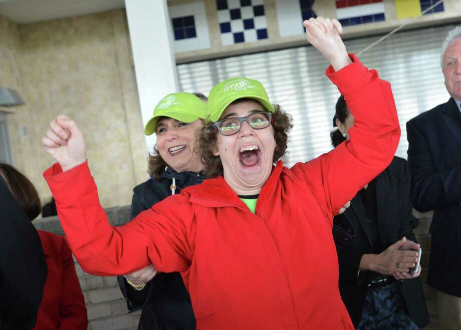 Ariel Levy from Westport celebrates with her mom Doree the news her father announced that their 'Team Ariel' has raised seventeen thousand dollars at this years Star 5K Run Walk & Stroll on Sunday May 6, 2018 in Westport Conn. The event in its 13th year was held at Sherwood Island State Park and benefits Star Inc. and its programs serving local people with intellectual and developmental disabilties Photo: Alex Von Kleydorff, Hearst Connecticut Media / Norwalk Hour