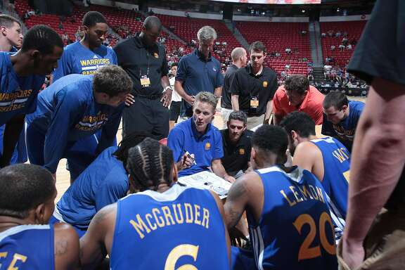 Golden State Warriors head coach Steve Kerr speaks to the huddle during his coaching debut against the New Orleans Hornets in Las Vegas, NV on Friday, July 11, 2014.