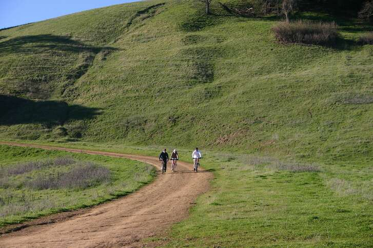 Pleasanton Ridge Cyclists � Pleasanton Ridge is a favorite East Bay destination for mountain bikers. Its rolling hills and deep valleys offer unique challenges along with spectacular views.        Photographer: Shelly Lewis, East Bay Regional Park District   The Chronicle has my permission to use this photo. � Shelly Lewis, 510-544-2208