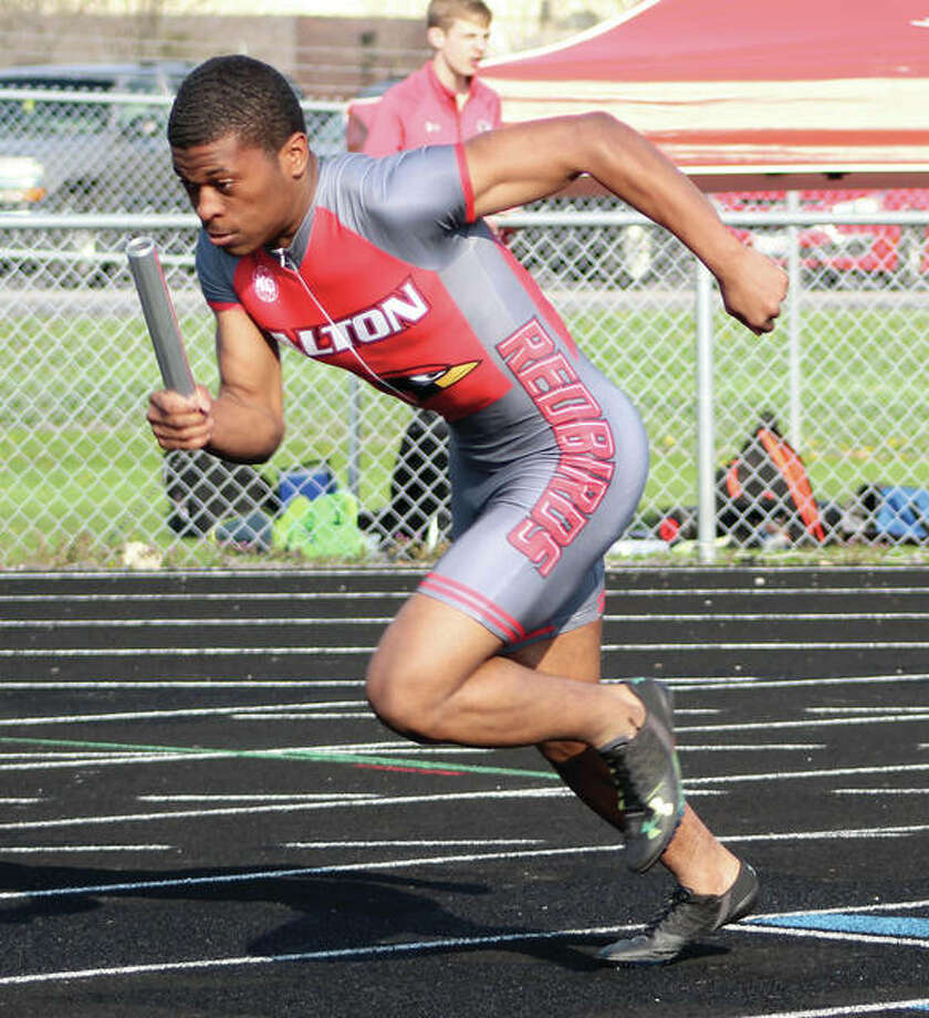Alton's Demontra Wilson breaks at the the start of the 4x100 relay during the Madison County Meet on April 24 in Highland. The Redbirds' 400-meter relay won the county race and came back Saturday to win the Collinsville Invitational with a time of 42.86 seconds. Photo:       Greg Shashack / The Telegraph