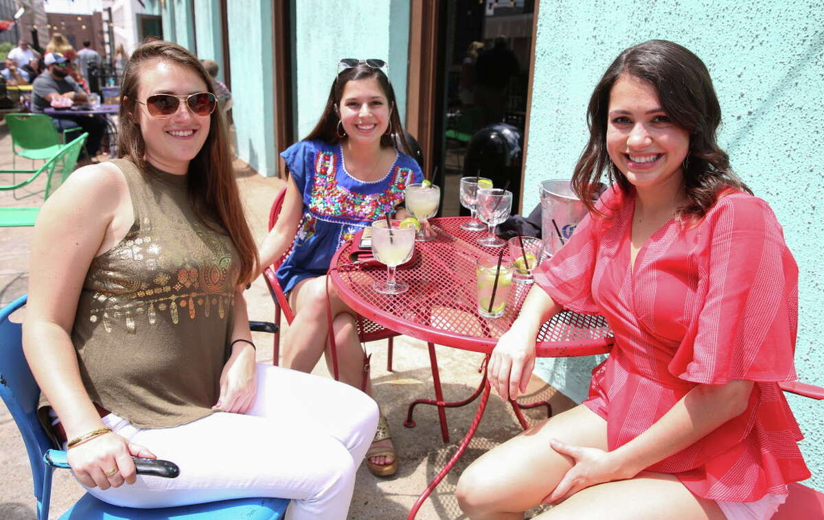 People pose for a photograph at El Big Bad celebrating Cinco de Mayo on Saturday, May 5, 2018, in downtown Houston.