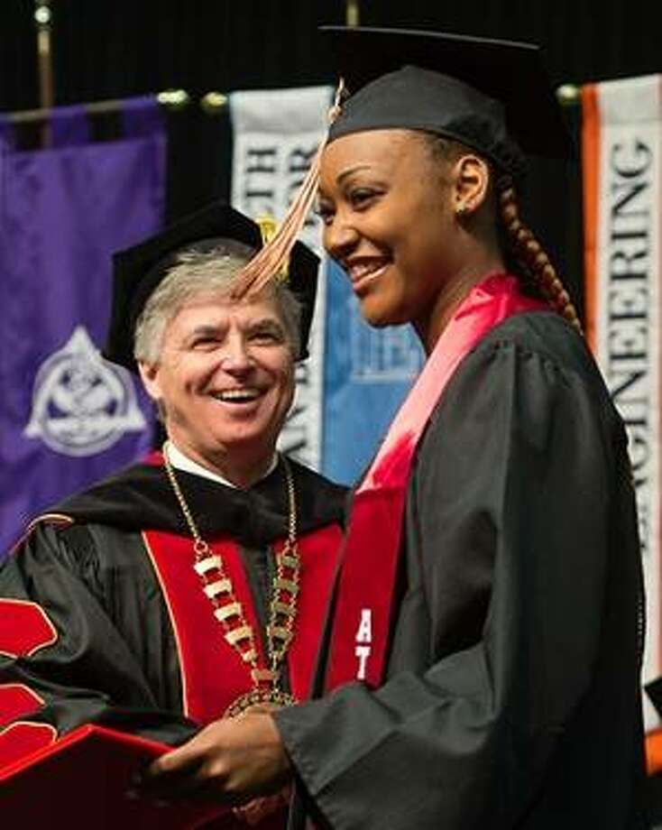 SIUE Chancellor Randy Pembrook congratulates a graduate. Photo:       For The Telegraph