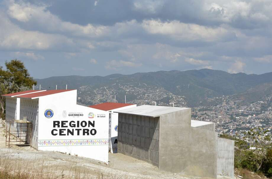View of the forensic state pantheon in Chilpancingo, Guerrero state, Mexico on November 21, 2017.  During 2017 the figures of homicides counted by the government broke records in several months, while places that had not been hit by violence today are a cause of concern. Grisly killings were once rare in the country's tourism hotspots but have risen in recent years as organized crime has grown.  / AFP PHOTO / FRANCISCO ROBLES / TO GO WITH AFP STORY by Sylvain ESTIBAL and Yussel GONZALEZ        (Photo credit should read FRANCISCO ROBLES/AFP/Getty Images) Photo: FRANCISCO ROBLES/AFP/Getty Images