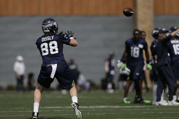 Seattle Seahawks tight end Will Dissly takes part in a drill Friday, May 4, 2018, during NFL football rookie camp in Renton, Wash. (AP Photo/Ted S. Warren)