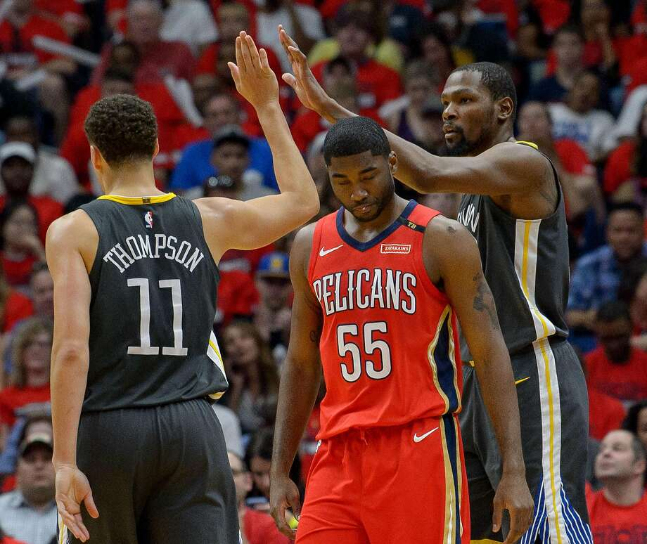 Golden State Warriors guard Klay Thompson (11) and Golden State Warriors forward Kevin Durant (35) celebrate next to New Orleans Pelicans forward E'Twaun Moore (55) during the first half of game 4 of the conference semifinal NBA playoffs at the Smoothie King Center in New Orleans, La. Sunday, May 6, 2018. Photo: Advocate Staff Photo By MATTHEW HINTON / The Advocate