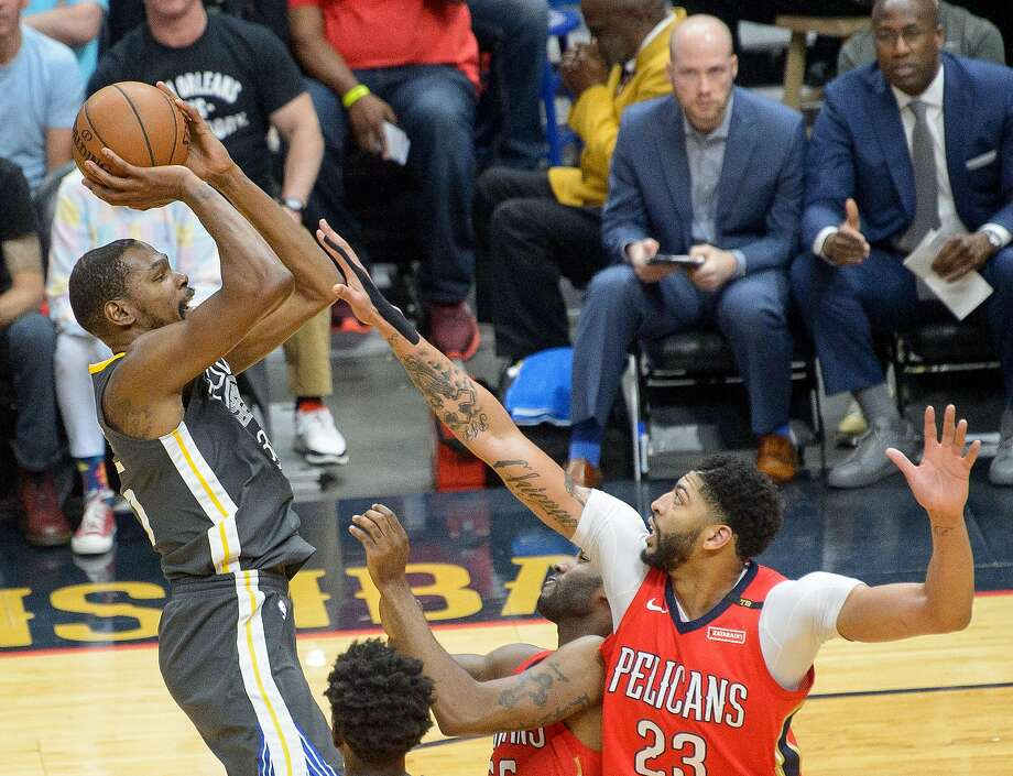 Golden State Warriors forward Kevin Durant (35) shoots over New Orleans Pelicans forward Anthony Davis (23) during the first half of game 4 of the conference semifinal NBA playoffs at the Smoothie King Center in New Orleans, La. Sunday, May 6, 2018. Photo: Advocate Staff Photo By MATTHEW HINTON / The Advocate