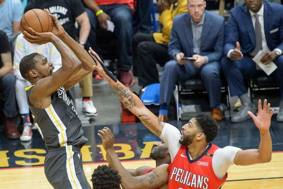 Golden State Warriors forward Kevin Durant (35) shoots over New Orleans Pelicans forward Anthony Davis (23) during the first half of game 4 of the conference semifinal NBA playoffs at the Smoothie King Center in New Orleans, La. Sunday, May 6, 2018.