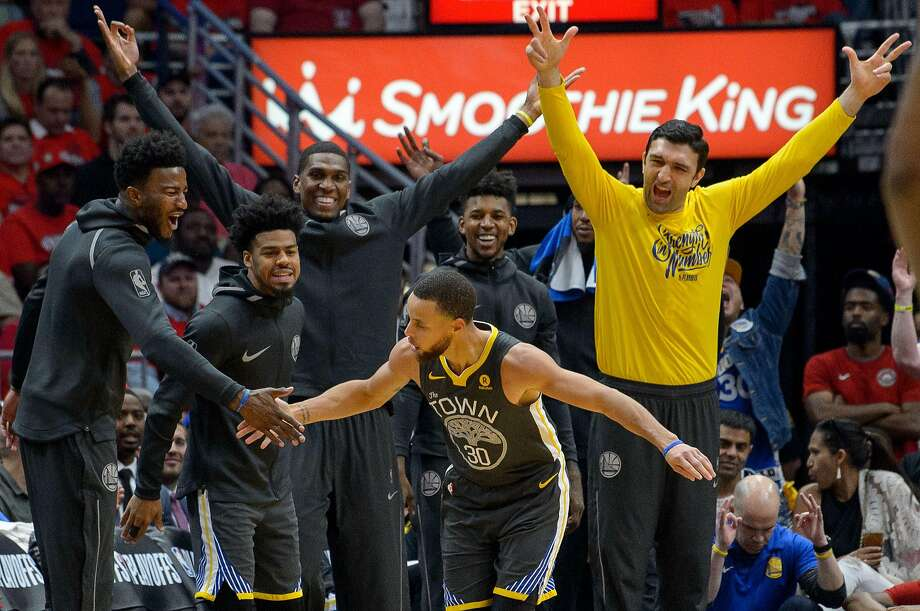 Golden State Warriors guard Stephen Curry (30) celebrates a three pointer with teammates against the New Orleans Pelicans during the first half of game 4 of the conference semifinal NBA playoffs at the Smoothie King Center in New Orleans, La. Sunday, May 6, 2018. Photo: Matthew Hinton / The Advocate