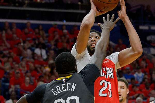 496b09dff56 3of6New Orleans Pelicans forward Anthony Davis (23) shoots against Golden  State Warriors forward Draymond Green (23) during the first half of game 4  of the ...