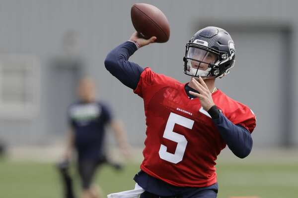 Seattle Seahawks quarterback Alex McGough passes Friday, May 4, 2018, during NFL football rookie camp in Renton, Wash. (AP Photo/Ted S. Warren)