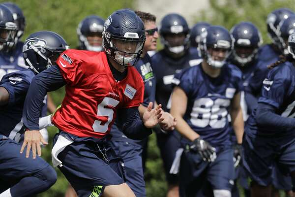 Seattle Seahawks quarterback Alex McGough runs Friday, May 4, 2018, during NFL football rookie camp in Renton, Wash. (AP Photo/Ted S. Warren)