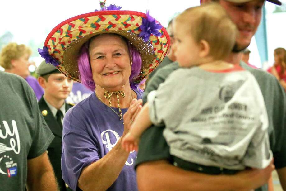 Diana Kammer walks in the survivor lap with her family during the Relay for Life event on Friday, May 4, 2018, at the Montgomery County Fairgrounds. Photo: Michael Minasi, Staff Photographer / © 2018 Houston Chronicle