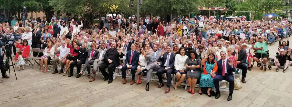 The Rev. Dr. Sallie Watson, general presbyter of Mission Presbytery, snapped this picture as she stood at the podium for the first day of the tricentennial's commemorative week in Main Plaza where the city?'s communities of faith gathered for prayers.