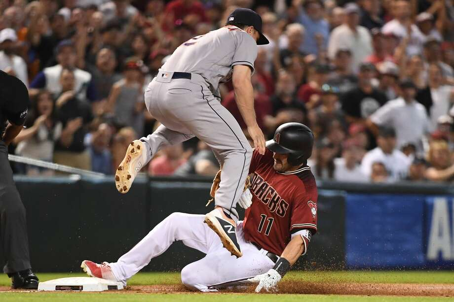PHOENIX, AZ - MAY 06:  A.J. Pollock #11 of the Arizona Diamondbacks triples in the sixth inning of the MLB game against Alex Bregman #2 of the Houston Astros at Chase Field on May 6, 2018 in Phoenix, Arizona.  (Photo by Jennifer Stewart/Getty Images) Photo: Jennifer Stewart/Getty Images